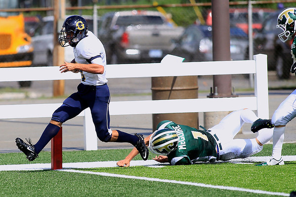 Record-Eagle/Jan-Michael Stump<br /> Gaylord wing Trae Hill (5) runs past Traverse City West defensive back Zack McGuire (1) for a touchdown Saturday at Thirlby Field.
