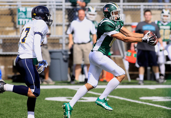 Record-Eagle/Jan-Michael Stump<br /> Traverse City West receiver Tyler Johnson (6) reaches for a catch in front of Gaylord's Collin Waters (87) Saturday at Thirlby Field.
