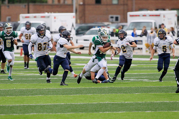 Record-Eagle/Jan-Michael Stump<br /> Traverse City West fullback Trent Hunt (42) runs past a group of Gaylord defenders in the second quarter Saturday at Thirlby Field.