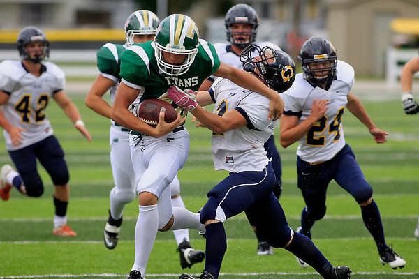 Record-Eagle/Jan-Michael Stump<br /> Traverse City West wing Garrett Bishop (48) stiff-arms Gaylord's Aaron Tarczon (2) in the second quarter Saturday at Thirlby Field.