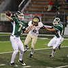 Record-Eagle/Keith King<br /> Traverse City West's Donny Cizek passes the ball against Ogemaw Heights Friday, October 12, 2012 at Thirlby Field in Traverse City.