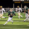 Record-Eagle/Keith King<br /> Traverse City West's Dustin Tucker runs with the ball against Ogemaw Heights Friday, October 12, 2012 at Thirlby Field in Traverse City.