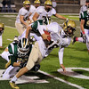 Record-Eagle/Keith King<br /> Traverse City West's Chris Doherty tackles Ogemaw Heights' Ben Hartley Friday, October 12, 2012 at Thirlby Field in Traverse City.