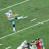 Dallas Cowboys punter gets off a kick. Cowboys at Atlanta Falcons, November, 2012.