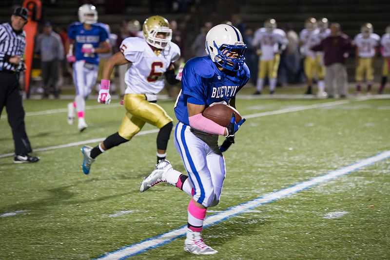 Leominster running back Angel Colina runs for a touchdown during the first quarter of a 24-14 win over Doherty at Doyle Field on Friday, Oct. 10, 2014. SENTINEL & ENTERPRISE / ALAN ARSENAULT