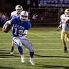Leominster QB Noah Gray runs for a first down. SENTINEL & ENTERPRISE / ALAN ARSENAULT