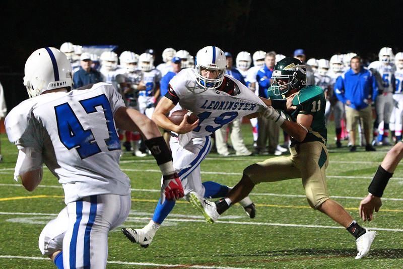 Leominster quarterback Noah Gray tries to escape from the grasp of Nashoba's Egan Bachtell during Friday's game in Bolton. SENTINEL & ENTERPRISE / SCOTT LAPRADE