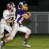 Monty Tech's Tyler Popp outruns a Quaboag defender for a touchdown. SENTINEL & ENTERPRISE / GARY FOURNIER