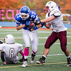 Lunenburg's Sean McNiff (Center) pushes past Ayer/Shirley's Brendon Percos (Right) for a touchdown Saturday in Lunenburg.<br /> SENTINEL & ENTERPRISE / ALAN ARSENAULT