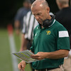 Fitchburg State University head coach Pat Haverty peruses the playlist during the Falcons' opening game against Becker. SENTINEL&ENTERPRISE/ Jim Marabello