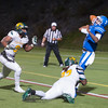 Fitchburg State Univ defenders Cyrick Watford (left) and Damar Collins force Becker QB Nas Sinkfield-Shelton to heave up a 3rd down incompletion to set up a 4th down that was unsucessful. FSU regained possession and ran out the clock for a 27-20 victory. SENTINEL&ENTERPRISE/ Jim Marabello