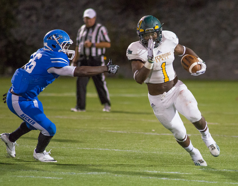 Fitchburg State RB Jevon Brown-Simpson makes a run upfield against Becker. The Falcons hung on to win 27-20 in their season opener in Leicester on Friday, Sept. 2, 2016. SENTINEL&ENTERPRISE/ Jim Marabello
