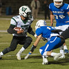 Wachusett RB Chris Villamarin makes a cut to try and get by Leominster's Domenic Fusco. SENTINEL&ENTERRPRISE/ Jim Marabello