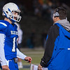 Leominster QB Noah Gray chats with head coach Dave Palazzi at the end of the 1st quarter against Wachusett. SENTINEL&ENTERPRISE/ Jim Marabello