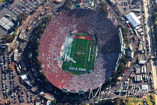 This image is the uncropped version of the next image, which was featured in Sports Illustrated and placed second in World Press Photo. <br /> <br /> Special discounts available. Please call or email for more information. Band and Football team editions available, as well.