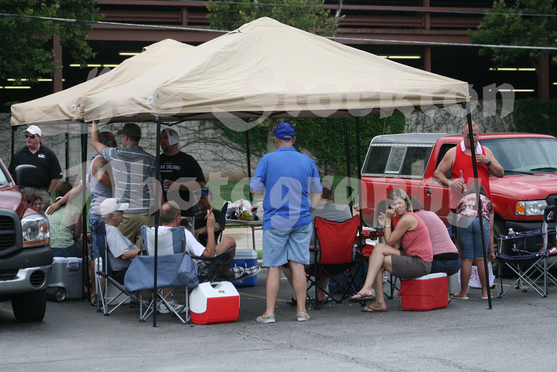 A few of the fans show up for a tailgate party before each game.