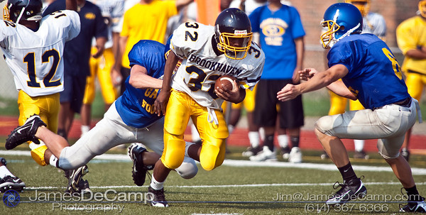 Brookhaven's #32 J. Williams carries the ball against Gahanna Lincoln High School during their morning scrimmage Friday August 14, 2009 at GHS. (©2009 James D. DeCamp | 614-367-6366 | http://www.JamesDeCamp.com)