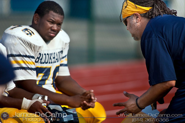Brookhaven High School coach Anthony Thornton, right, talks with his players Friday Morning August 14, 2009 at a scrimmage at Gahanna Lincoln High School. (©2009 James D. DeCamp | 614-367-6366 | http://www.JamesDeCamp.com)