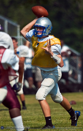 Olentangy Liberty High School's QB Scott MacKie passes off to a teammate during a scrimmage Saturday Morning August 15, 2009 at the New Albany Middle School practice field. New Albany High School, Canal Winchester High School, and Olentangy Liberty High School competed with one another during the pre-season scrimmage. (Photo by James D. DeCamp 614-367-6366)  http://www.JamesDeCamp.com