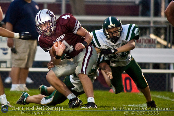 Columbus Academy High School #4 Austin Peterman runs the ball as Northridge High School's #24 Thomas Williams comes in for the tackle during the first quarter of play in the teams season opener held at Columbus Academy High School Friday night August 28, 2009. The game was postponed late in the second quarter due to lightning.  (Photo by James D. DeCamp 614-367-6366)  http://www.JamesDeCamp.com