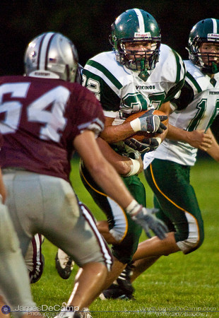 Northridge High School's #32 Tony Stanley runs against the Columbus Academy High School defense in the first quarter of play in the teams season opener held at Columbus Academy High School Friday night August 28, 2009. The game was postponed late in the second quarter due to lightning. (Photo by James D. DeCamp 614-367-6366)  http://www.JamesDeCamp.com