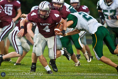 Columbus Academy High School #4 Austin Peterman runs the ball against the Northridge High School defense during the first quarter of play in the teams season opener held at Columbus Academy High School Friday night August 28, 2009. The game was postponed late in the second quarter due to lightning.  (Photo by James D. DeCamp 614-367-6366)  http://www.JamesDeCamp.com