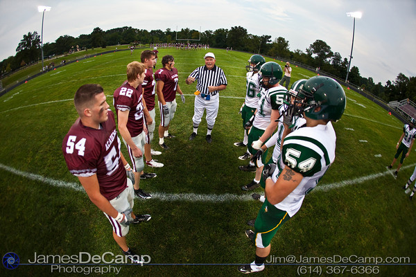 Columbus Academy High School and Northridge High School team captains get instructions from Referee Charles Warthen before the first quarter of play in the teams season opener held at Columbus Academy High School Friday night August 28, 2009. The game was postponed late in the second quarter due to lightning.  (Photo by James D. DeCamp 614-367-6366)  http://www.JamesDeCamp.com