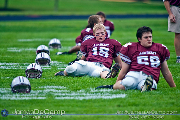 Columbus Academy High School #15 Josh Hill stretches with his team before play against Northridge High School in the teams season opener held at Columbus Academy High School Friday night August 28, 2009. The game was postponed late in the second quarter due to lightning.  (Photo by James D. DeCamp 614-367-6366)  http://www.JamesDeCamp.com