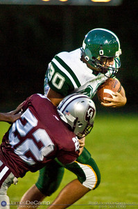 Northridge High School's #30 Alex Blake is taken down by Columbus Academy High School's #22 Jeff May in the second quarter of play in the teams season opener held at Columbus Academy High School Friday night August 28, 2009. The game was postponed late in the second quarter due to lightning.   (Photo by James D. DeCamp 614-367-6366)  http://www.JamesDeCamp.com