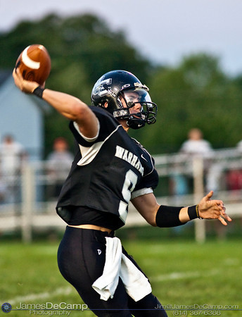 Westerville Central High School Quarterback #9 Kyle Stephenson unloads a pass against Big Walnut High School during the second quarter of play in the teams season opener held at Westerville Central High School Saturday evening August 29, 2009. The game was postponed Friday night and moved to Saturday afternoon due to violent weather.  (Photo by James D. DeCamp 614-367-6366)  http://www.JamesDeCamp.com