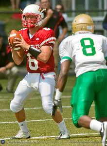 Saint Charles Preparatory High School Quarterback #6 Shane Bauman looks to unload the ball from the pocket in the third quarter of play against the Youngstown Ursuline High School in the teams season opener held at Saint Charles Preparatory High School Saturday afternoon August 29, 2009. The game was postponed Friday night and moved to Saturday afternoon due to violent weather.  (Photo by James D. DeCamp 614-367-6366)  http://www.JamesDeCamp.com