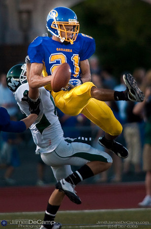 Gahanna High School #21 CJ Bryant rises to try and intercept a pass intended for Mason High School's #18 Ronald Swonger during the first quarter of play at Gahanna High School Friday night September 11, 2009.  (©2009 James D. DeCamp | 614-367-6366 | http://www.JamesDeCamp.com)