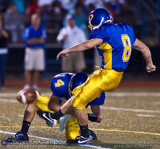 Gahanna High School's #8 Tyler Grassman kicks the extra point after a touchdown in the second quarter against Mason High School defense at Gahanna High School Friday night September 11, 2009. Holding the ball is #14 Tanner Zwelling. (©2009 James D. DeCamp | 614-367-6366 | http://www.JamesDeCamp.com)