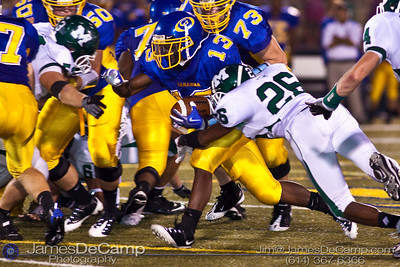 Gahanna High School's #13 Bryan Walls finds a hole in the Mason High School defensive line during the second quarter of play at Gahanna High School Friday night September 11, 2009. Mason's #26 Kirk Smith attempting the tackle.(©2009 James D. DeCamp | 614-367-6366 | http://www.JamesDeCamp.com)