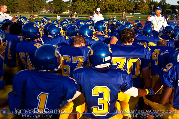 Gahanna High School Head Football Coach John Snoad, right, talks with his team before taking on Mason High School at Gahanna High School Friday night September 11, 2009. (©2009 James D. DeCamp | 614-367-6366 | http://www.JamesDeCamp.com)