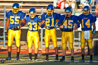 Gahanna High School #21 CJ Bryant, center, joins arms with other team captains before the coin toss with Mason High School at Gahanna High School Friday night September 11, 2009.  Other players from left - #55 Darien Moody, #33 Nick Earl, #45 Tyler Hayes, #14 Tanner Zwelling. (©2009 James D. DeCamp | 614-367-6366 | http://www.JamesDeCamp.com)
