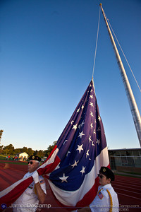 American Legion 797 Color Guard members Jerry McDaniel and Diane McDaniel prepare to raise the flag before the Gahanna High School Friday night football game September 11, 2009. (©2009 James D. DeCamp | 614-367-6366 | http://www.JamesDeCamp.com)