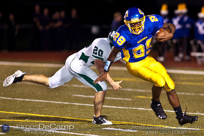 Gahanna High School's #29 Sante Cook runs the ball around Mason High School's 20 David Richmond during the second quarter of play at Gahanna High School Friday night September 11, 2009. (©2009 James D. DeCamp | 614-367-6366 | http://www.JamesDeCamp.com)