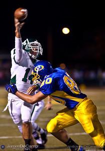 Gahanna High School #80 Brandon Lee comes in for a sack as Mason High School's Quarterback #14 Alex Farren unloads a pass during the first quarter of play at Gahanna High School Friday night September 11, 2009. (©2009 James D. DeCamp   614-367-6366   http://www.JamesDeCamp.com)