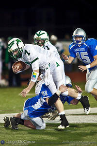 Bishop Ready High School's #51 Eddy Bahen  brings down Anna High School Quarterback #7 Wesley Hunsucker Friday night November 6, 2009 at Dublin Scioto High School. (Photo by James D. DeCamp 614-367-6366) http://www.JamesDeCamp.com