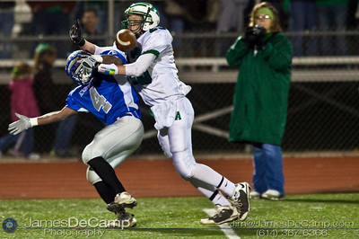 Bishop Ready High School's #4 Derek Farmer and Anna High School #23 Derek Billing vie for a pass Friday night November 6, 2009 at Dublin Scioto High School. (Photo by James D. DeCamp 614-367-6366) http://www.JamesDeCamp.com