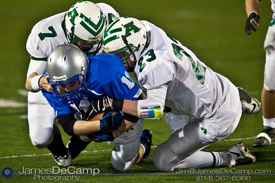 Bishop Ready High School's #11 Jordan Carnes is brought down by Anna High School #7 Wesley Hunsucker and #23 Derek Billing Friday night November 6, 2009 at Dublin Scioto High School. (Photo by James D. DeCamp 614-367-6366) http://www.JamesDeCamp.com