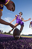 "Reynoldsburg High School's Jimmy McKean holds for kicker #16  during warm-ups before the start of their teams game against Toledo Scott High School at Reynoldsburg High School Friday night September 3, 2010.  (©2010 James D. DeCamp) <a href=""http://www.JamesDeCamp.com"">http://www.JamesDeCamp.com</a>"