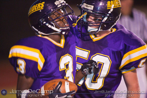 Reynoldsburg High School's #3 Stanley Peterson  gets a congrats from #50 Timothy Fryer after scoring a touchdown against Toledo Scott High School in the second quarter of play at Reynoldsburg High School Friday night September 3, 2010.  (©2010 James D. DeCamp) http://www.JamesDeCamp.com