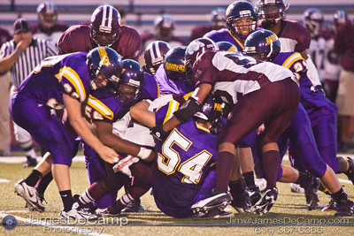 Reynoldsburg High School's defense brings down a Toledo Scott High School in the second quarter of play at Reynoldsburg High School Friday night September 3, 2010.  (©2010 James D. DeCamp) http://www.JamesDeCamp.com