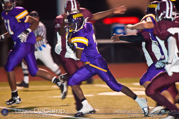 Reynoldsburg High School's #3 Stanley Peterson runs in for a touchdown against the Toledo Scott High School defense in the second quarter of play at Reynoldsburg High School Friday night September 3, 2010.  (©2010 James D. DeCamp) http://www.JamesDeCamp.com
