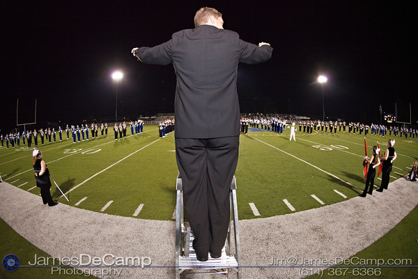 Bexley High School Band Director watches his Whitehall Yearling High School counterpart as they direct their combined bands playing during the halftime show at Bexley High School Thursday night September 16, 2010.  (©2010 James D. DeCamp) http://www.JamesDeCamp.com