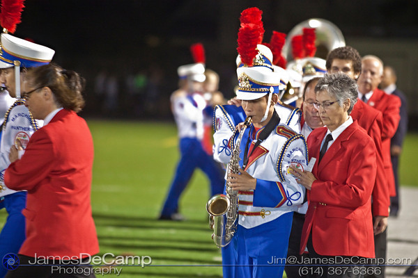 Ohio State School for the Blind Band Member Nien Nguyen and his guide Maryann Stockum, right, march during the halftime show at Bexley High School Thursday night September 16, 2010. This was the first performance of the season for the band that has earned national attention.  (©2010 James D. DeCamp) http://www.JamesDeCamp.com