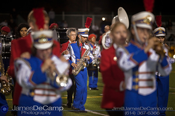 Ohio State School for the Blind Band Member Nien Nguyen and his guide Maryann Stockum, rear, march during the halftime show at Bexley High School Thursday night September 16, 2010. This was the first performance of the season for the band that has earned national attention.  (©2010 James D. DeCamp) http://www.JamesDeCamp.com