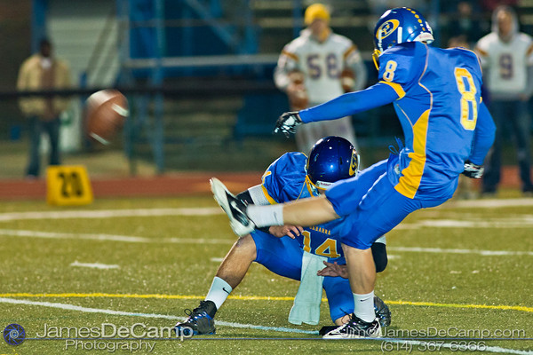 Gahanna High School's #14 Tanner Zwelling holds the ball for kicker #8 Tyler Grassman in the second quarter of play at Gahanna High School Friday night October 22, 2010.(© James D. DeCamp / http://www.OhioPhotojournalist.com / 614-367-6366)